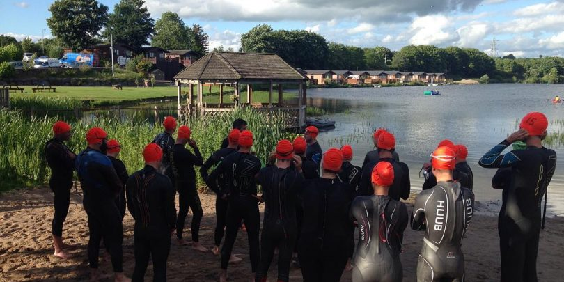 Orange Is The New Black. Monday night open water swimmers ready to get started on the #ironman distance swim at Water's Edge, Carnforth.