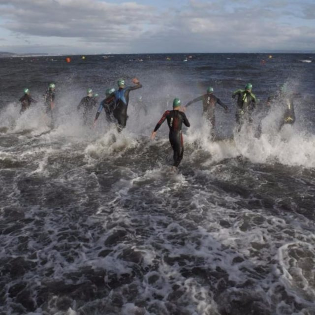 Nigel Neil braves the tough swim at Ironman 703 Edinburghhellip
