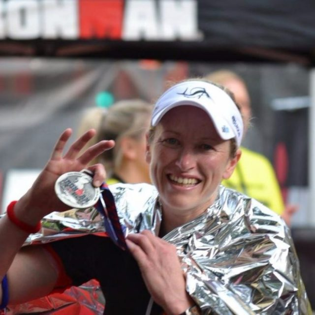 Jenny EvansHill with her finisher medal at Ironman UK 2017